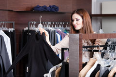 Girl is looking for a perfect cloth which is vogue Stock Photos
