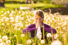 Girl in meadow and has hay fever or allergy Royalty Free Stock Photos