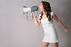 Girl with megaphone Royalty Free Stock Photography