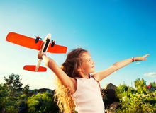 Girl playing with plane Stock Photos