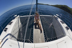 Girl relaxing on a catamaran - South Pacific Royalty Free Stock Image