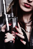 Girl with a revolver Stock Images