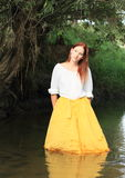 Girl in skirt in water Stock Photo