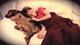 Girl sleeping with dog Stock Photo