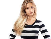 Girl in a striped sweater tired Royalty Free Stock Photography