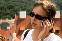 Girl using mobile phone Stock Images