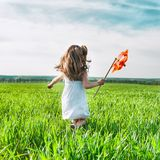 Girl with a windmill in hand Stock Image
