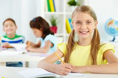 Girl at workplace Stock Image