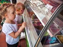 Girls choosing ice cream flavour Stock Photo