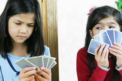 Girls playing cards, one is cheating Stock Image