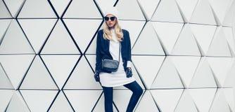 Glamorous blonde on the street. urban fashion style Stock Photography