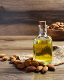 Glass bottle with almond oil Stock Photo