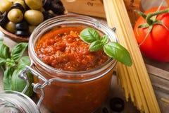 Glass jar with homemade tomato pasta sauce Royalty Free Stock Photo