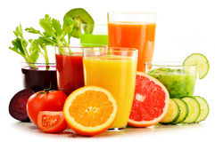 Glasses with fresh organic vegetable and fruit juices on white Stock Photo