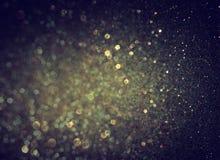 Glitter vintage lights background. light gold and black Stock Photo