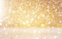 Glitter vintage lights background. light gold and black. defocused Royalty Free Stock Photos
