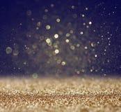 Glitter vintage lights background. light gold and black. defocused. Royalty Free Stock Photo