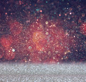 Glitter vintage lights background. light red and black. defocused. Royalty Free Stock Photo