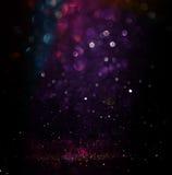 Glitter vintage lights background. light silver, purple, blue, gold and black. defocused. Royalty Free Stock Image