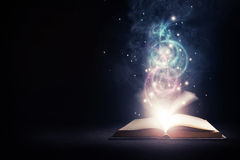 Glowing Book with colors Royalty Free Stock Image