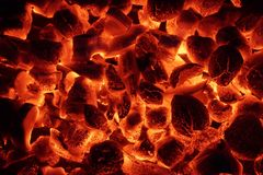 Glowing Charcoal Briquettes Background Texture Stock Photography