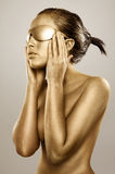 Gold bodypainted girl Stock Photography