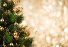 Gold Christmas tree background of defocused lights Royalty Free Stock Photography