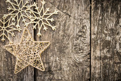 Gold Christmas tree decorations on grunge wood Stock Photography