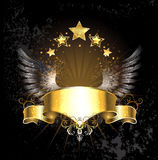 Gold ribbon with wings Royalty Free Stock Photography