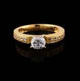 Gold ring with brilliant on black Stock Photo