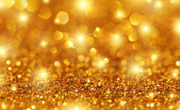 Gold Glitter Stars Background Stock Photo