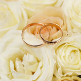 Gold wedding rings on a bouquet of flowers Stock Image