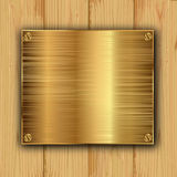 Gold on a wood Royalty Free Stock Photo