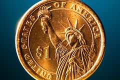 Golden dollar coin on blue background Stock Images