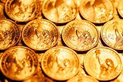 Golden dollar coins background Stock Photos