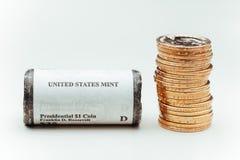 Golden dollar coins Stock Photography