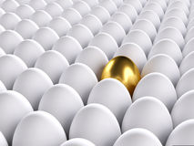 Golden egg standing out from the others. 3d render Stock Photos