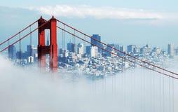 Golden Gate Bridge & San Francisco under fog Stock Photos