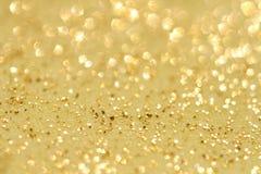 Golden glitter sparkles dust  background Stock Images