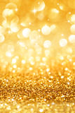 Golden glitter and stars for christmas background Royalty Free Stock Images