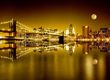 Golden New York and Brooklyn Bridge Stock Images