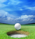 Golf ball on lip Stock Images