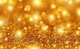 Gouden Fonkelingsachtergrond Stock Foto