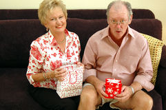 Grandparents with gifts Royalty Free Stock Images