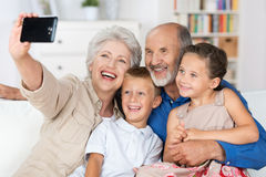 Grandparents and grandchildren with a camera Royalty Free Stock Photography