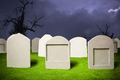 Graveyard at Halloween night Royalty Free Stock Image