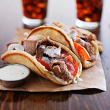 Greek gyros with tzatziki sauce and fries Royalty Free Stock Images