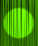 Green curtain with a spotlight Royalty Free Stock Images