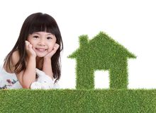Green grass house with girl Stock Images