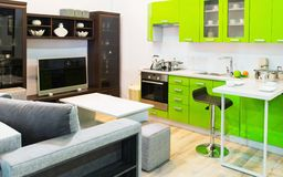 Green kitchen and room clean interior design Stock Photography